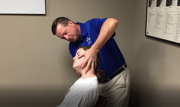 Dr. Klinginsmith Treating a Patient for Neck Pain and Headaches in Kearney, Nebraska