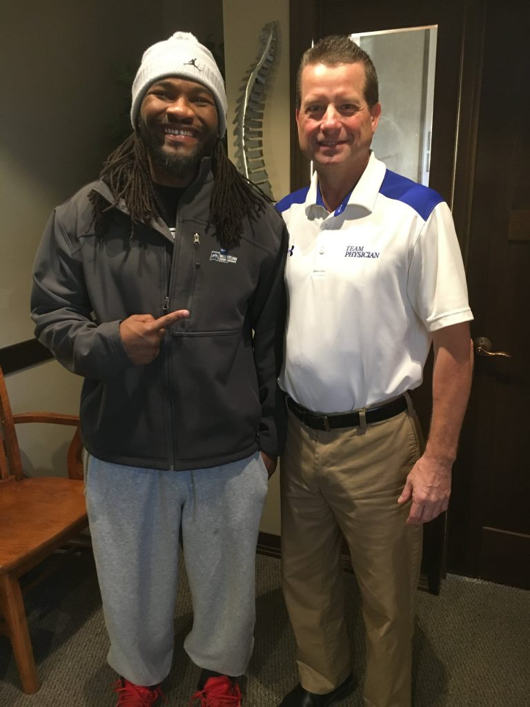 UNK Loper great, Romero Cotton, receives chiropractic treatment in Kearney, Nebraska.